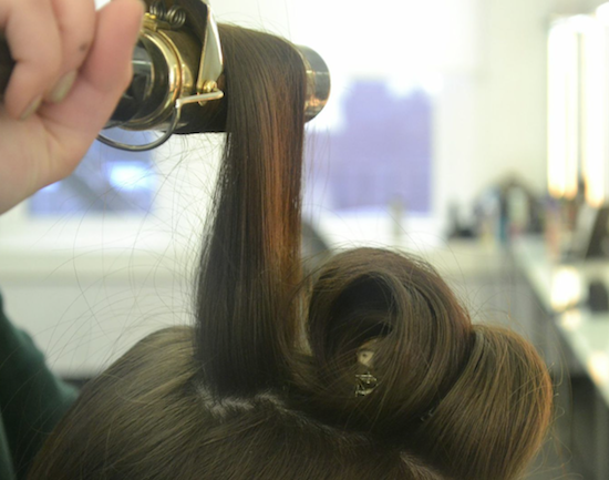 Curl all of your hair with a 1.5-inch curling iron to help add to the fullness of the braid.